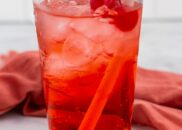 shirley temple in glass with cherry and straw