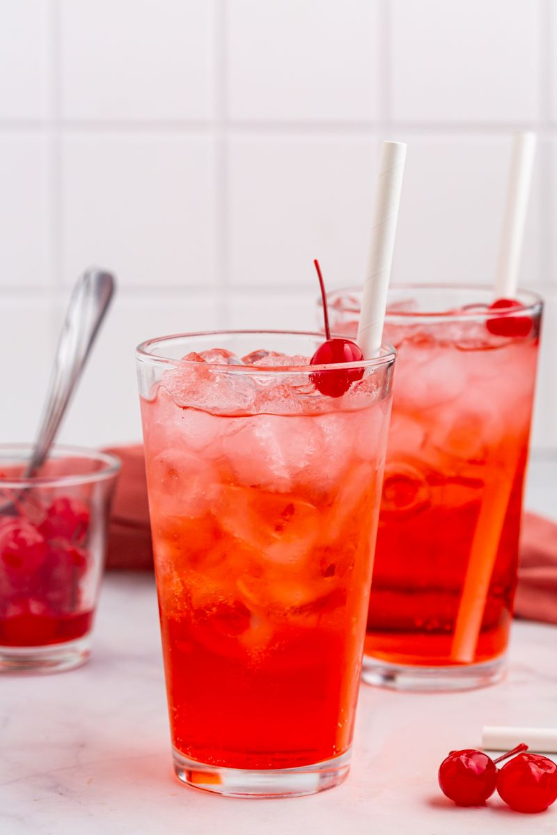 shirley temples in two glasses with cherry and straws
