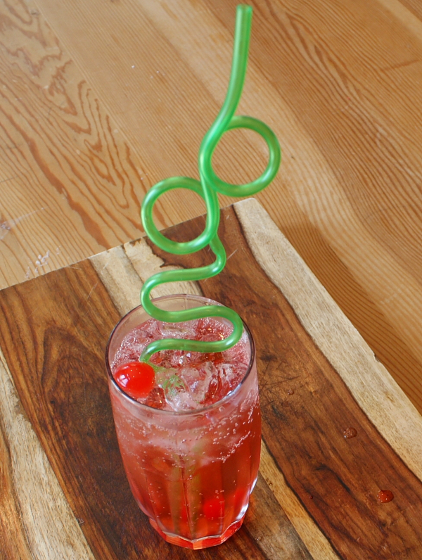 Shirley Temple with a squiggly straw