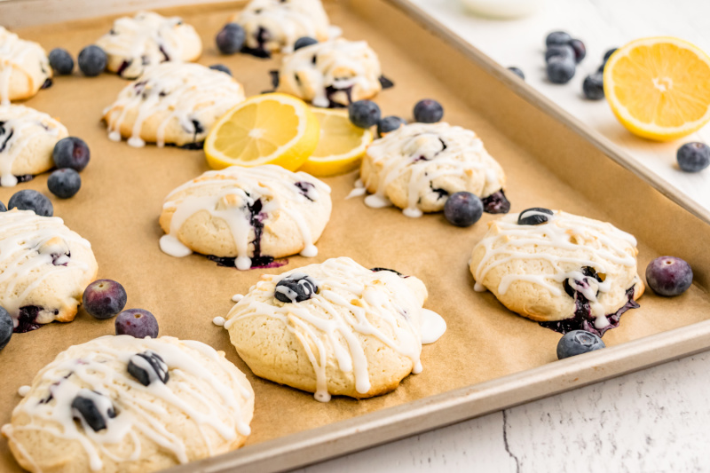 iced blueberry cookies on baking sheet