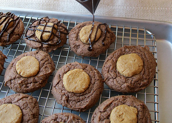 Peanut Butter Brownie Cookies getting chocolate drizzle