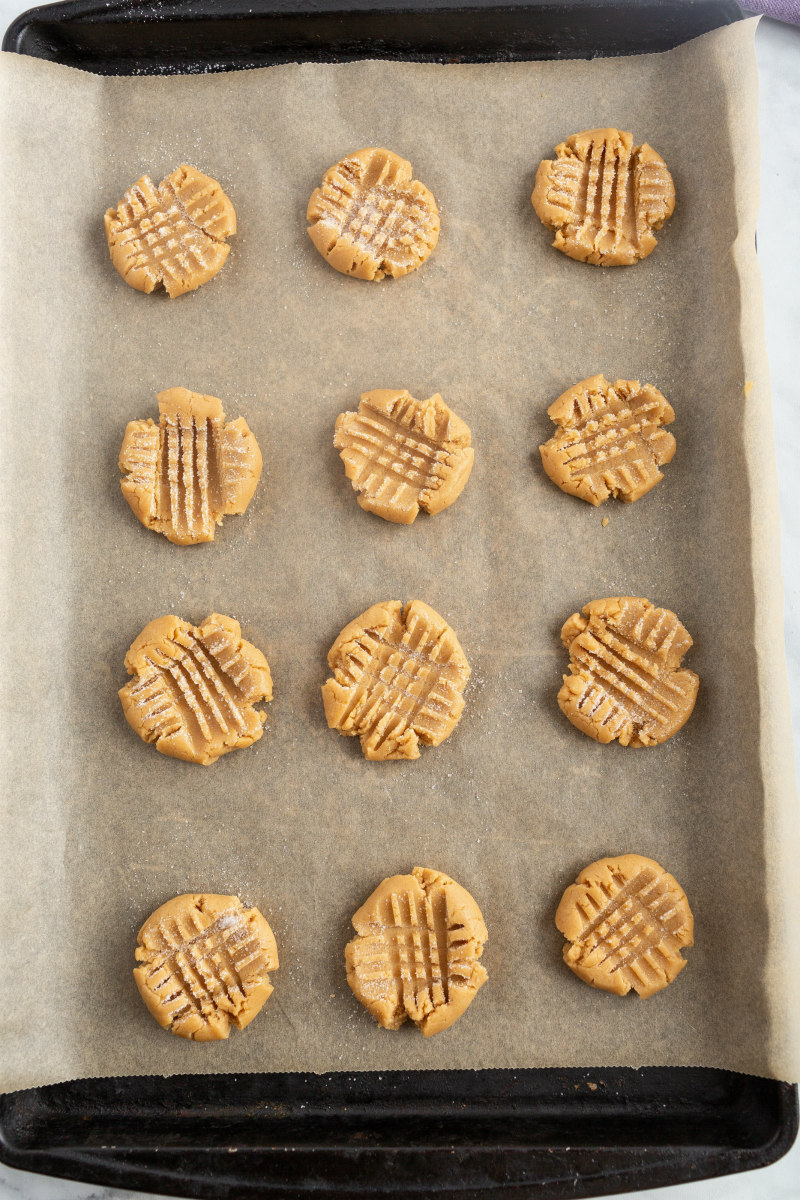 peanut butter cookies on a baking sheet waiting for oven