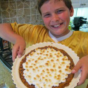 RecipeBoy holding s'mores pie