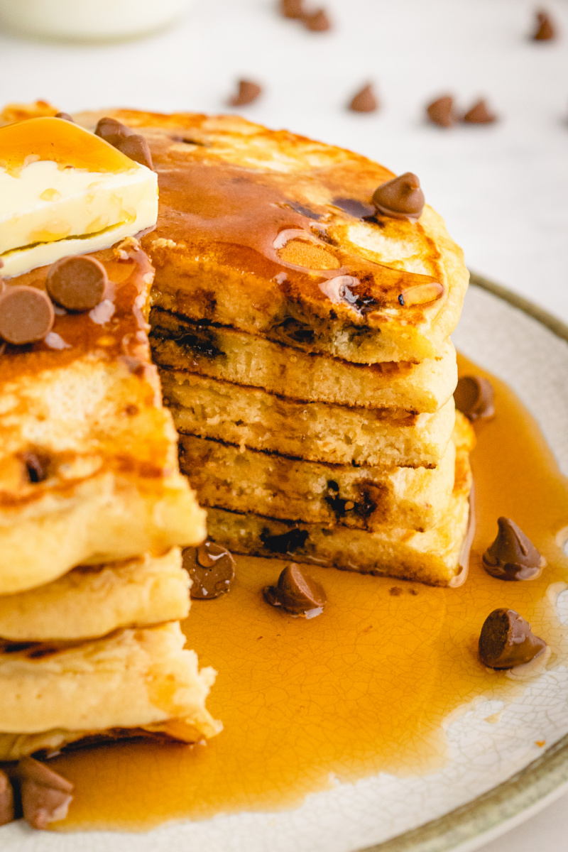 stack of pancakes with a big slice out of them
