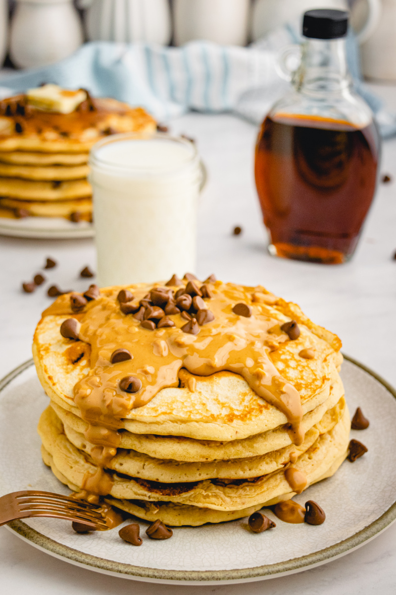 stack of pancakes with peanut butter and chocolate chips on top