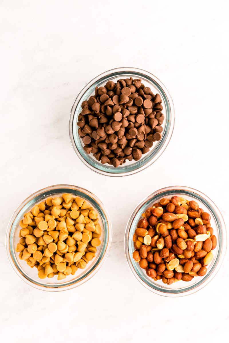 bowls of chocolate chips, peanuts and butterscotch chips
