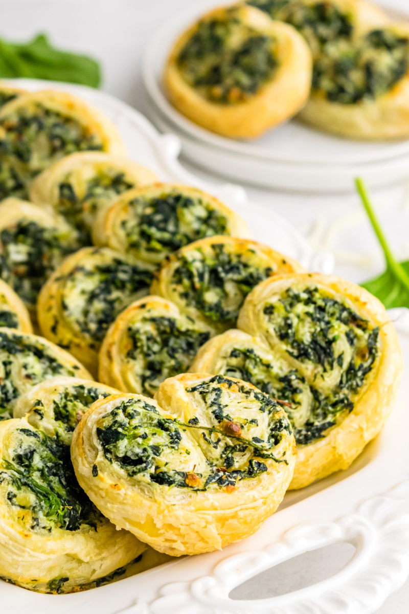 spinach palmiers on a white platter