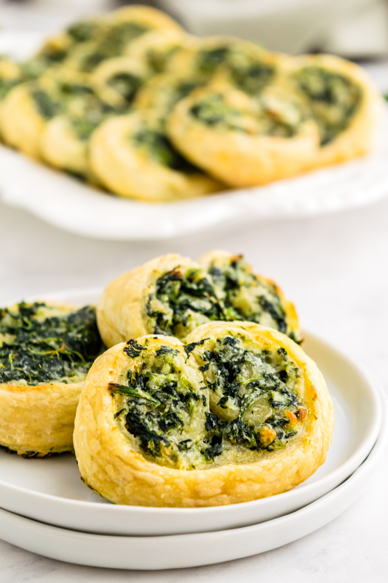 serving of spinach palmiers on a white plate
