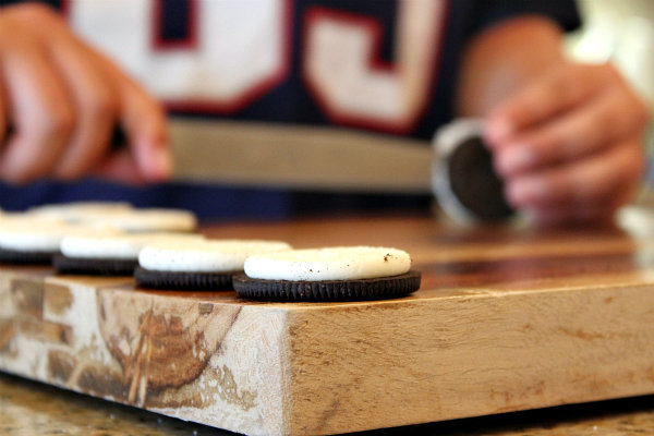 Making peanut butter cup stuffed oreos