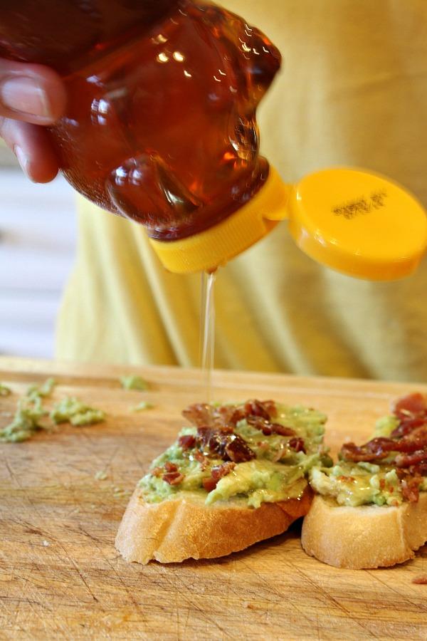 Avocado Bacon Toast topped with Honey