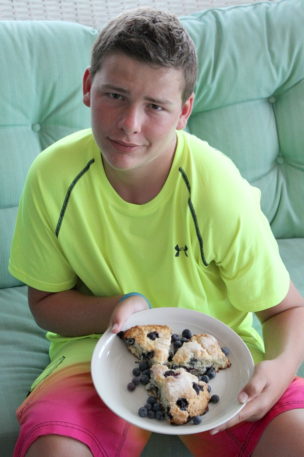 RecipeBoy holding Cape Cod Blueberry Scones on a white plate
