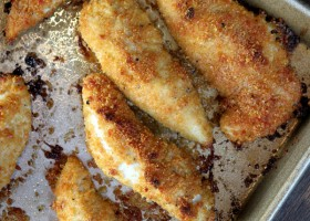 baked parmesan chicken tenders on a baking sheet