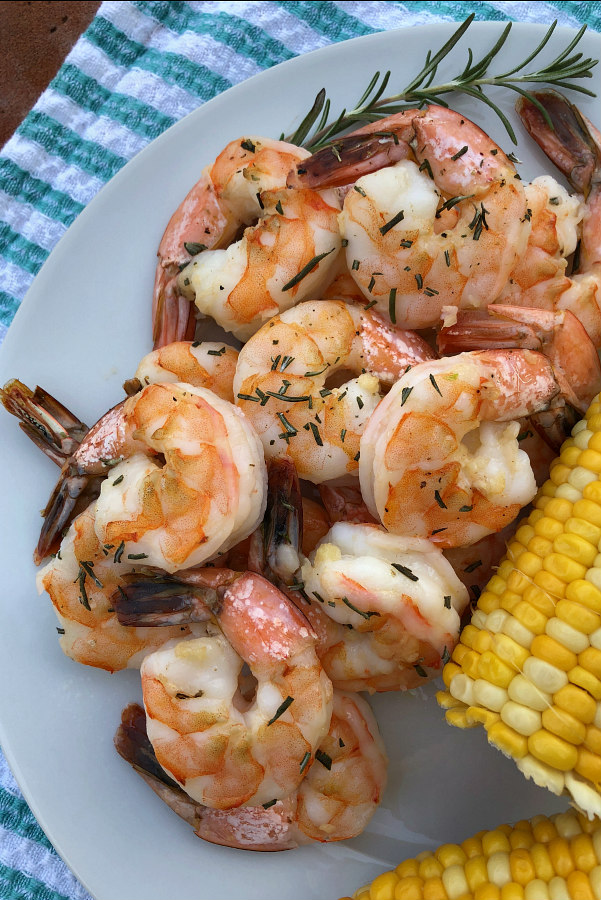 Easy Baked Garlic Shrimp served with corn on the cob