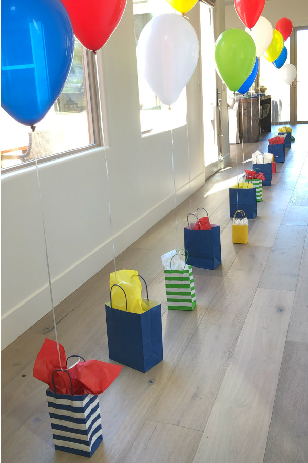 Birthday celebration idea: attaching balloons to gifts using the number of gifts to match the age