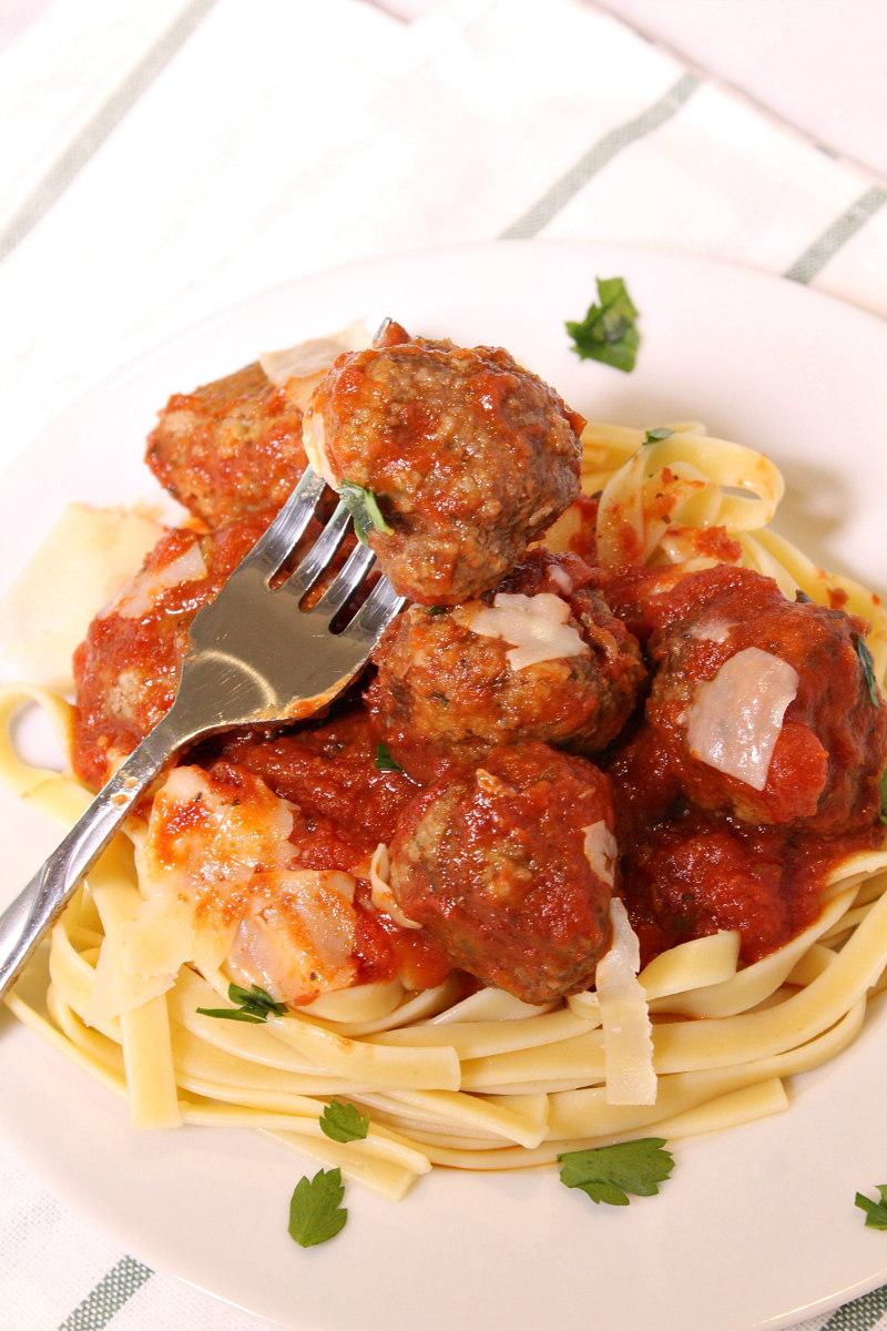 Easy Homemade Meatballs served over pasta