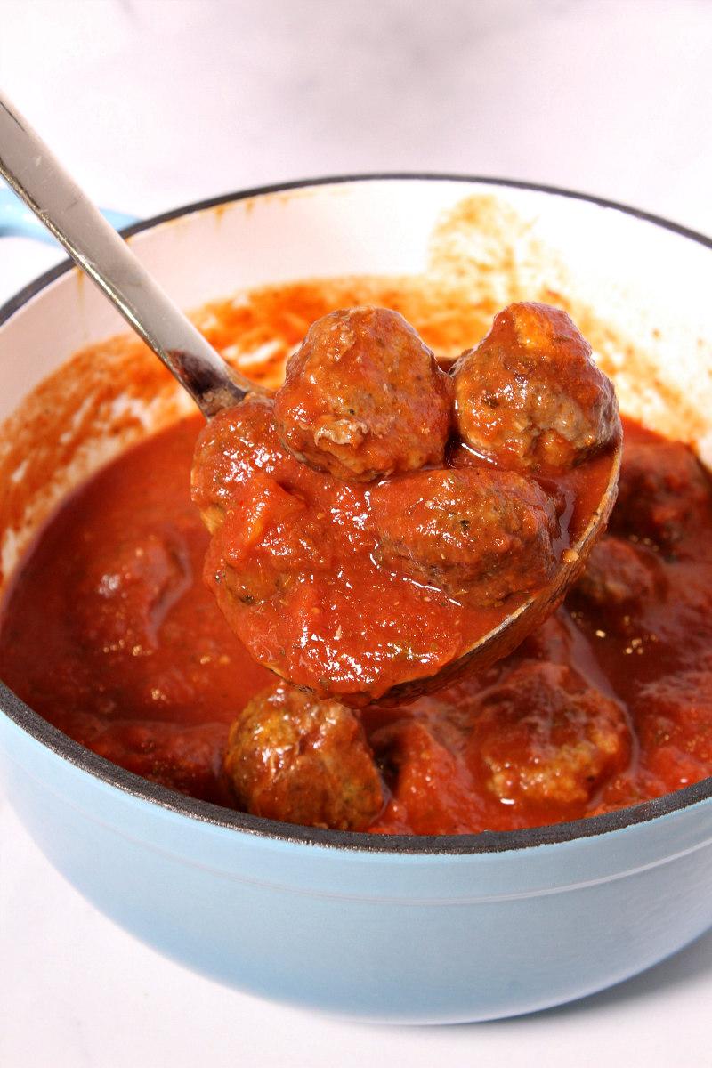 Easy Homemade Meatballs in pot of marinara