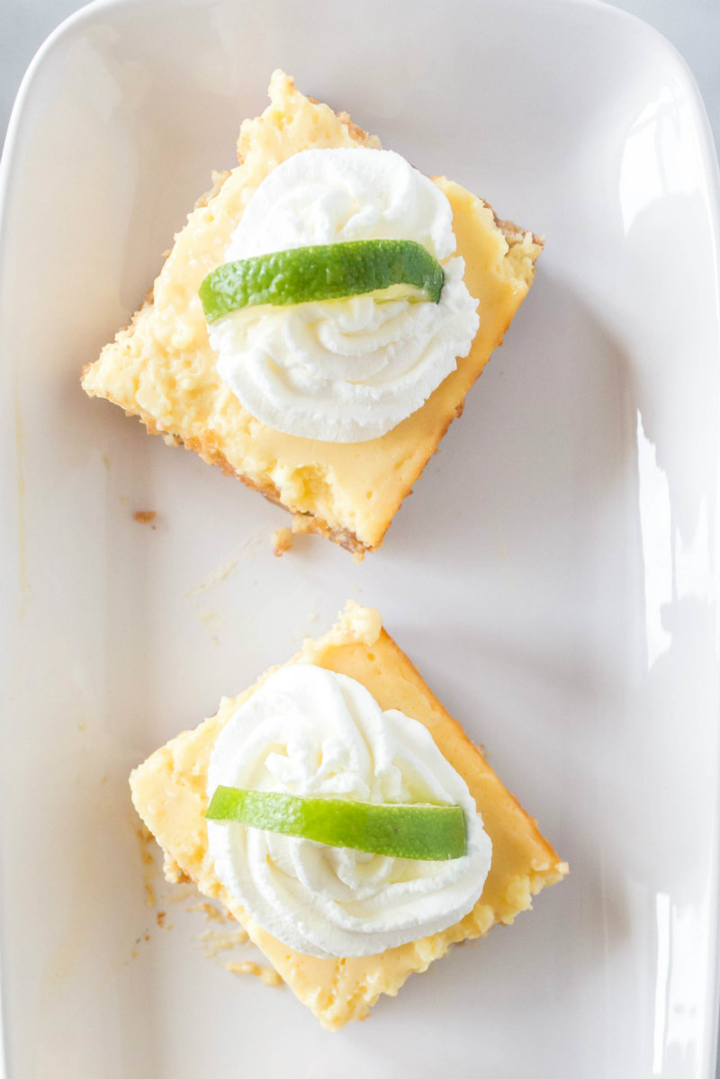 overhead shot of key lime bars on a white plate