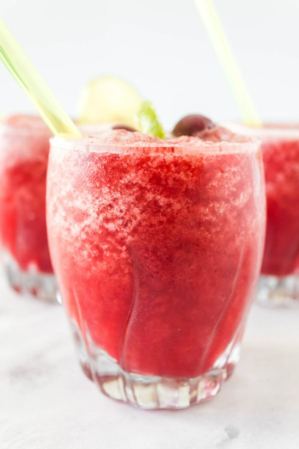 cherry lime slushies in glasses - 3 of them) with straws.