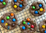 overhead shot of chocolate cake mix m&m cookies cooling on a cooling rack