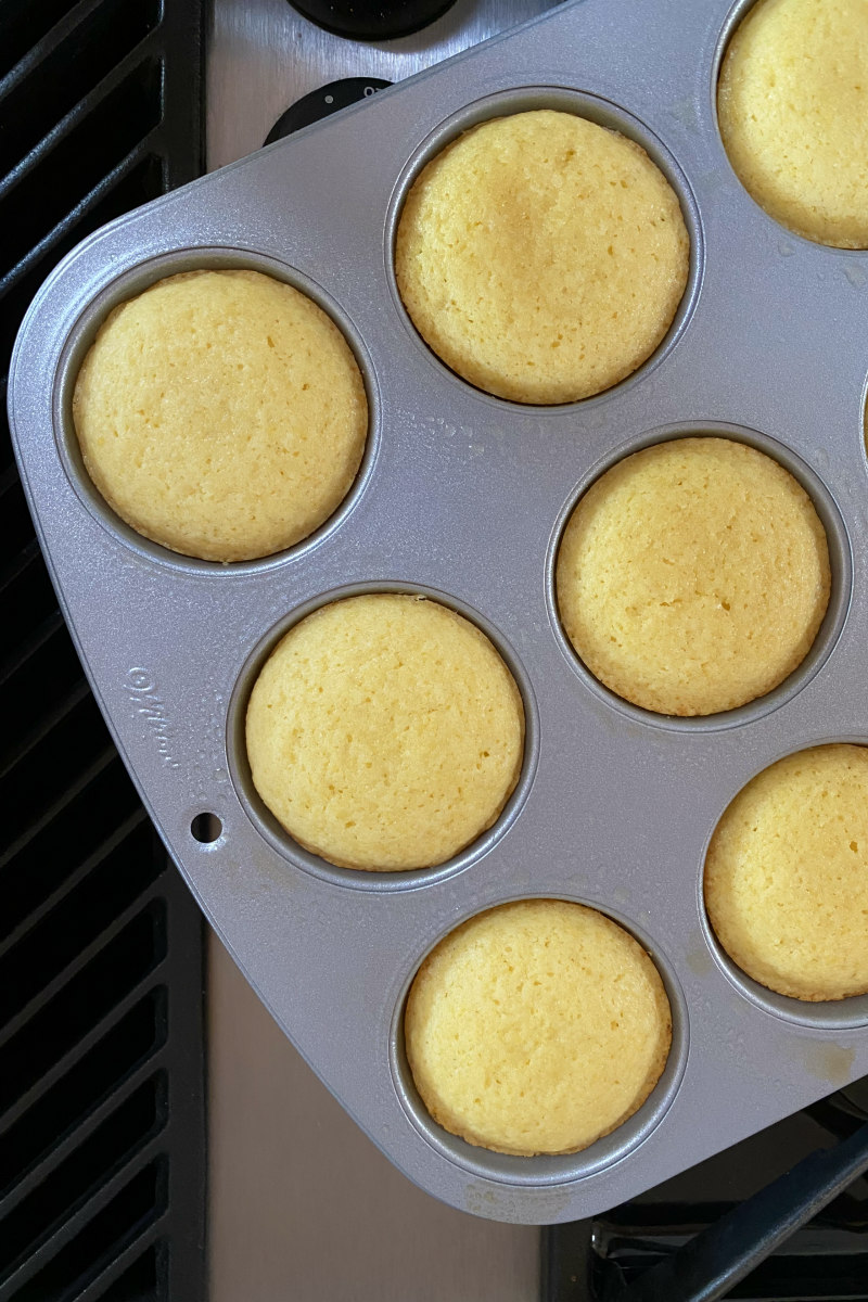 overhead shot of lemon muffins in a muffin pan
