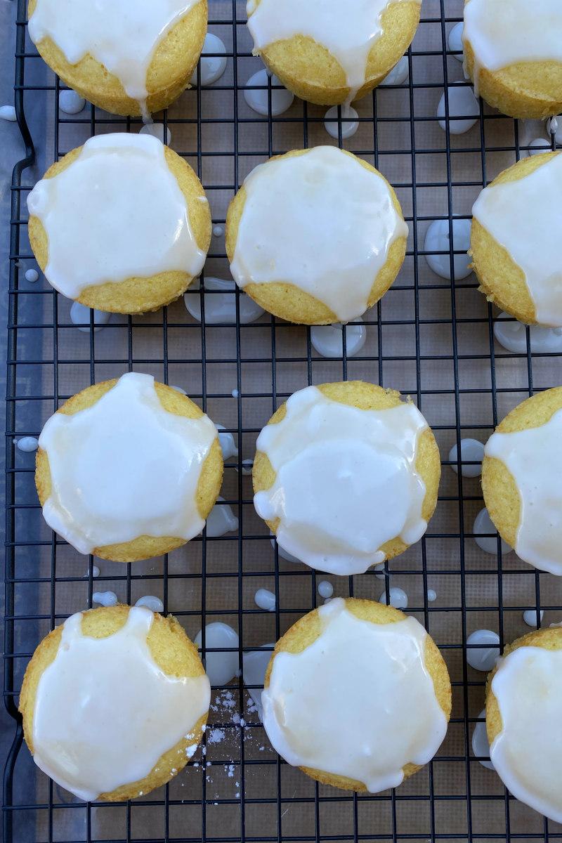 overhead shot of glazed lemon muffins on a rack
