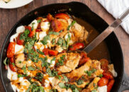 caprese chicken in a black skillet