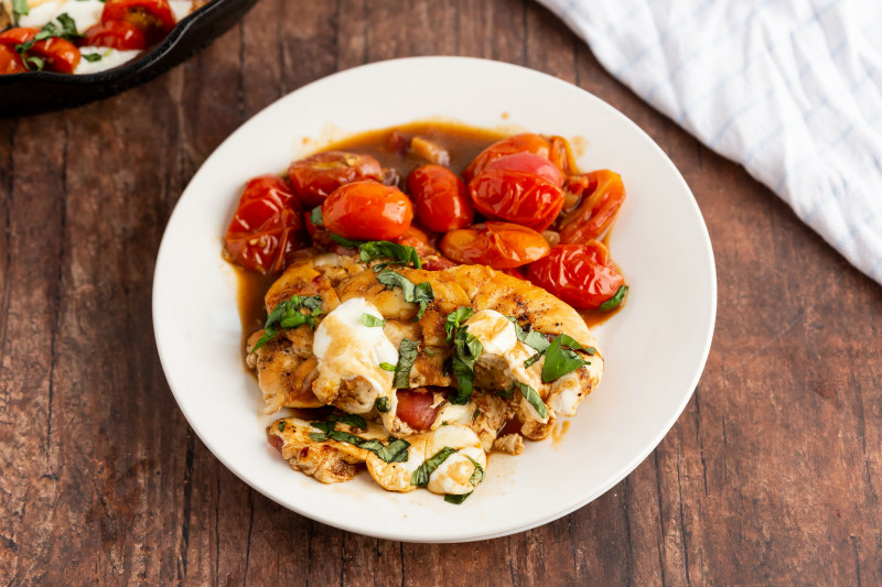 caprese chicken serving on white plate