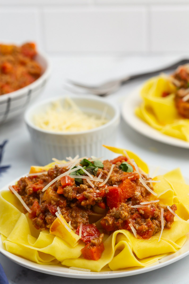 pappardelle bolognese on a white plate