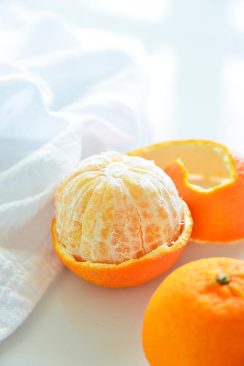 orange half unpeeled