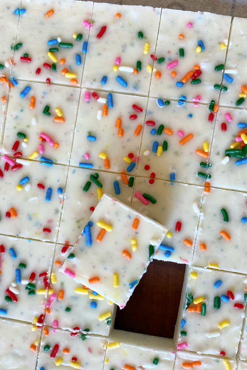 funfetti frosting fudge cut into pieces on cutting board
