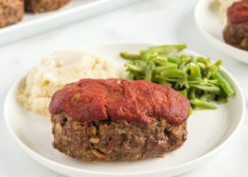 meatloaf on plate with potato and beans