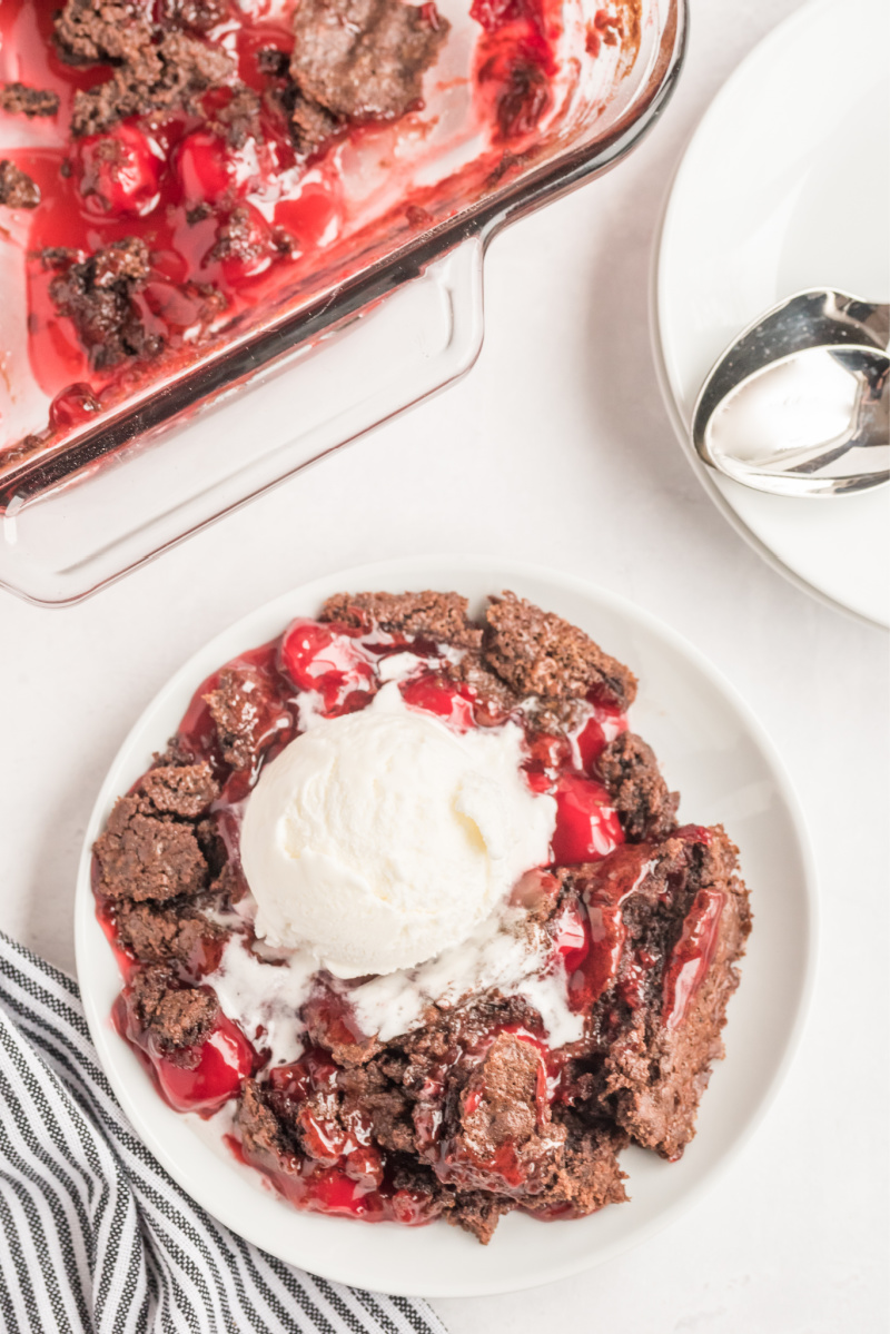 serving of chocolate cherry dump cake with ice cream on top