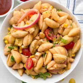 white bowl of BBQ chicken pasta salad