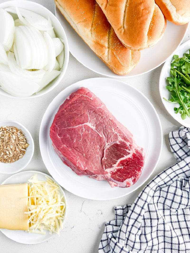 ingredients displayed for making french onion steak sandwiches
