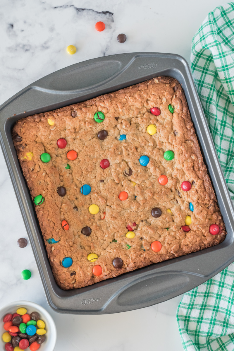 easy monster cookie bars in pan just out of oven
