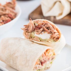 slow cooker pork burrito cut in half