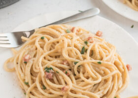 spaghetti carbonara serving on white plate