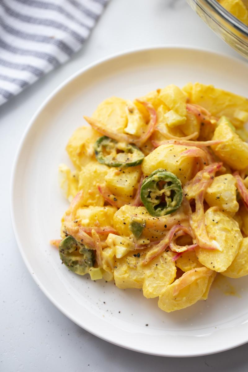 texas potato salad serving on white plate