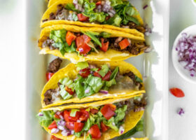 baked ground beef tacos on a platter