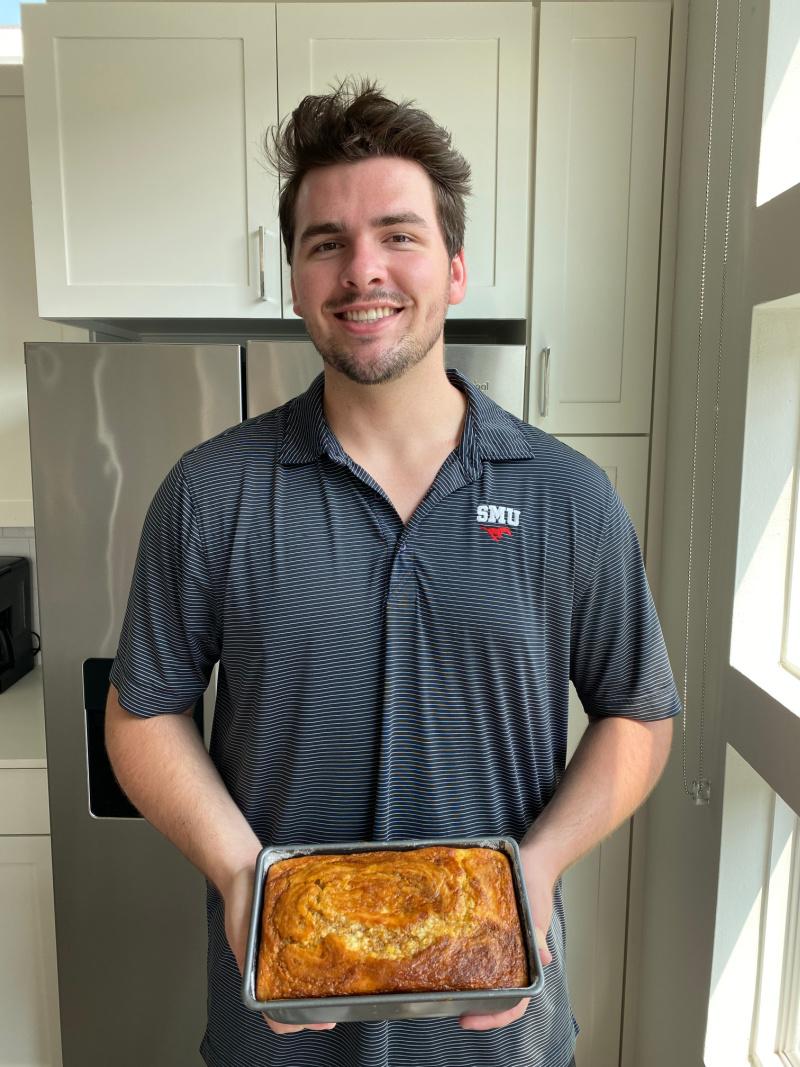 recipeboy holding loaf of pumpkin bread