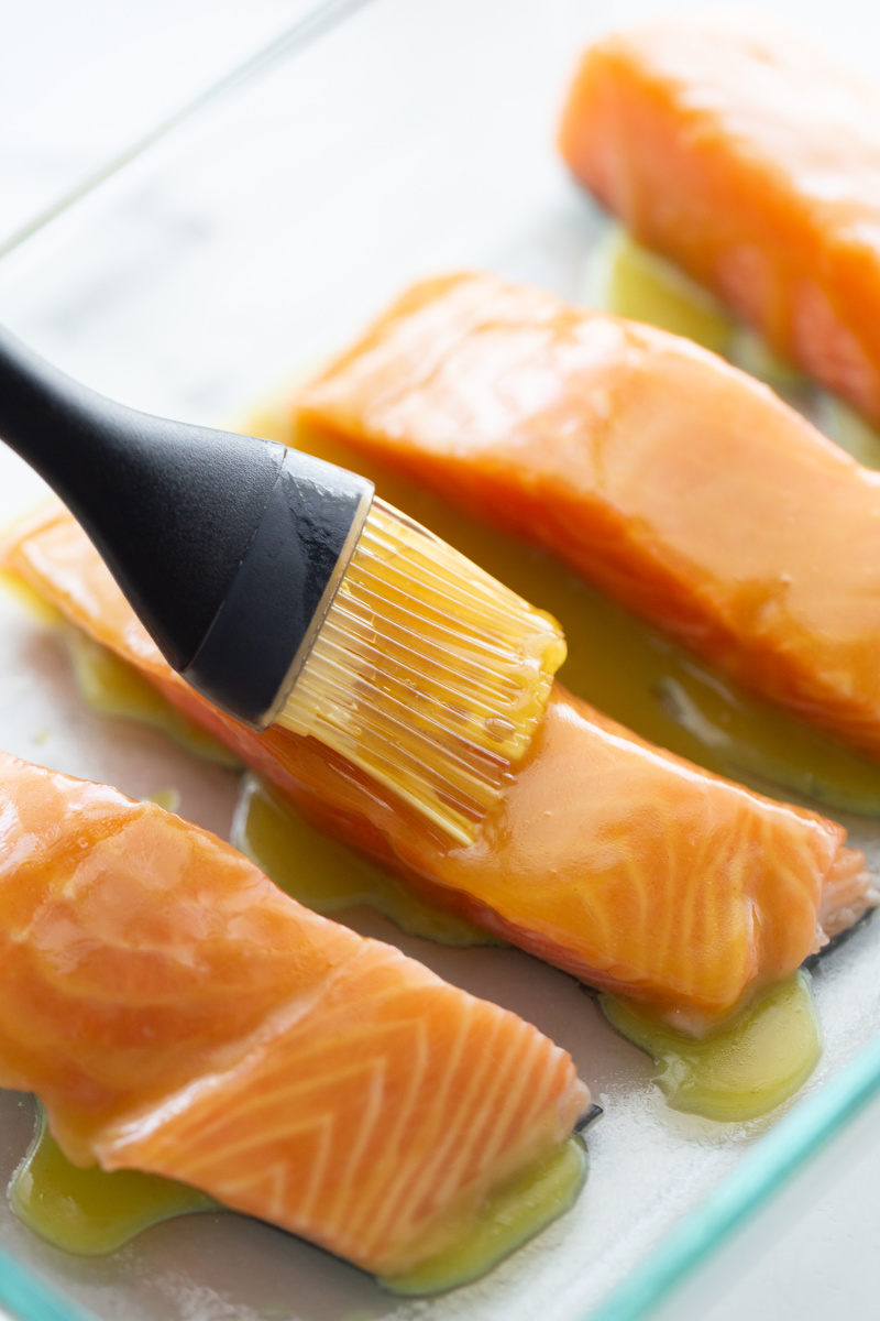 brushing salmon filets with sauce