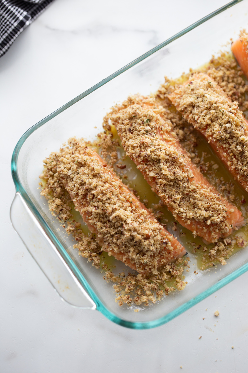 honey dijon and pecan baked salmon ready for oven in baking dish