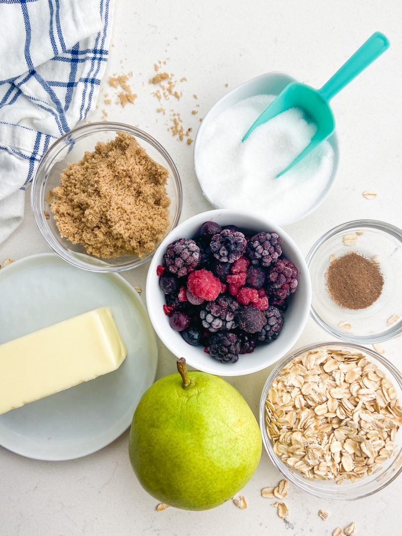 ingredients displayed for making pear and berry crisp