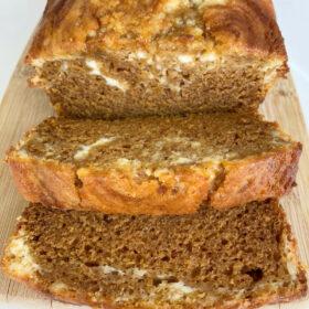 loaf of pumpkin cheesecake bread sliced