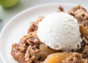 caramel apple dump cake serving with ice cream on top