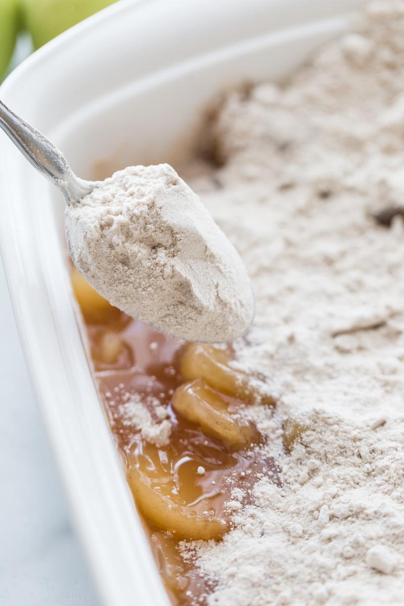 sprinkling cake mix into pan